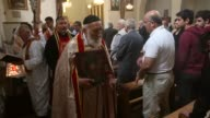 TS Churchgoers reach to touch an icon of the Virgin Mary held by Father Hanno Teber during Mass at the St Jacob Syrian Orthodox Antioch Church on...