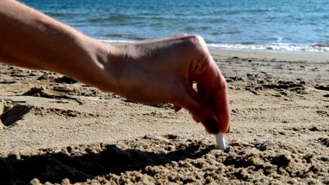Cigarette butt on beach