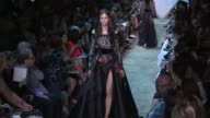 Cindy Bruna Sara Sampaio their fellow models and designer Elie Saab on the runway for the Elie Saab Couture Fall Winter 2017 fashion show in Paris on...