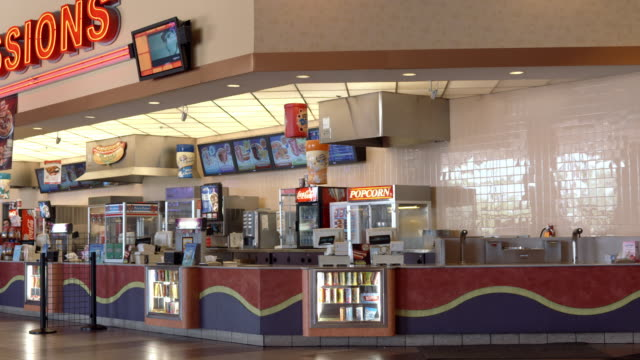 WS PAN cinema multiplex lobby area with concession counter and popcorn machines