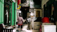 Cinemagraph of Grandmother holding with basket in market.