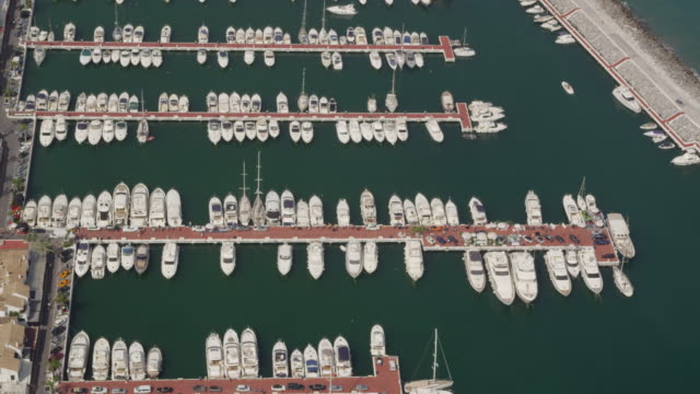 circling aerial view of Puerto Banus marina on western edge of Marbella