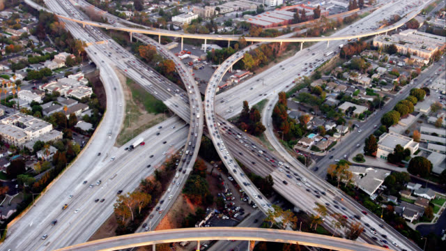 circling aerial view of the I405 and I10 freeway intersection, one of the original 'spaghetti junctions', RED R3D 4K, 4K, 4KMSTR