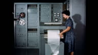 CU circuitry of translation machine / woman inspects translation machine printout Inside a Russian translation machine on September 01 1959