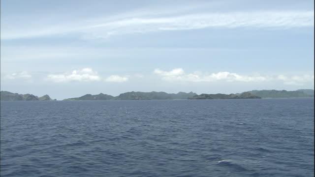Cirrus clouds streak the sky over Japan's Bonin Islands in the Pacific Ocean.
