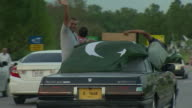 Citizens celebrating 70 years since the Partition of India on a road in Islamabad Pakistan