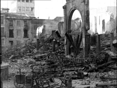 City building burning in battle / interior of shelled building burning / PAN rubble of shelled buildings / soldiers entrenched on Toledo street by...