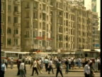 MS city centre street with pedestrians and traffic, Apartments in background, Egypt