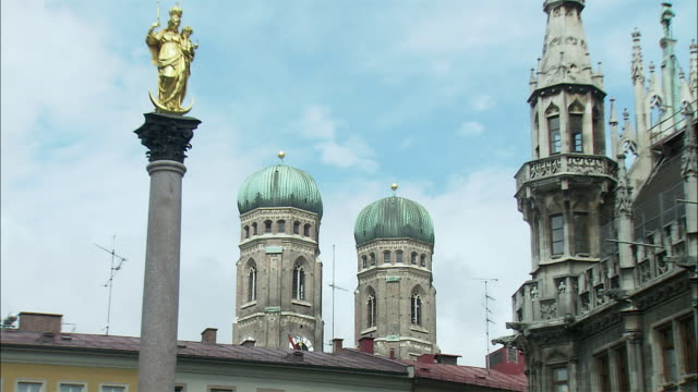 ZI MS City hall tower and St. Mary's Column with Frauenkirche towers in background, Marienplatz, Munich, Bavaria, Germany