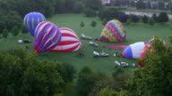 City Hot-Air Balloons Inflating at Dawn