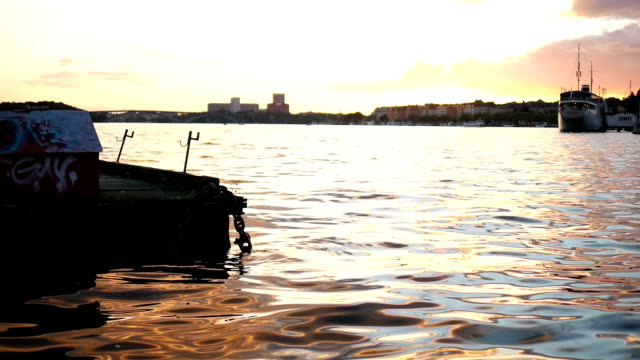 City lake at sunset slow motion