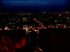 City lights at night from top of Edinburgh Castle with cannon in foreground