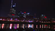 City lights reflecting on Cumberland River TU WS City skyline with ATandT Building on left