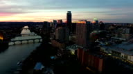 City lights turn on As the Sun Sets and Austin night life comes to life Aerial View Capital City of Texas Skyline Cityscape