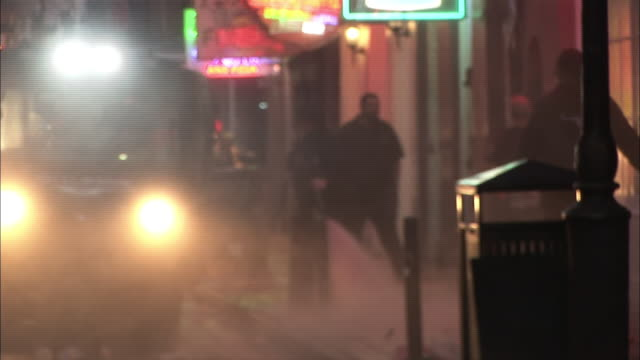A city maintenance crew cleans trash off a street in New Orleans.