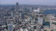 WS POV AERIAL City near river / Yokohama, Japan