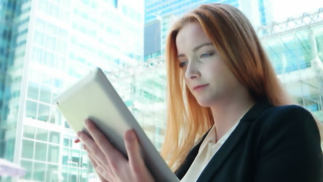 City office girl, using digital tablet, cityscape.