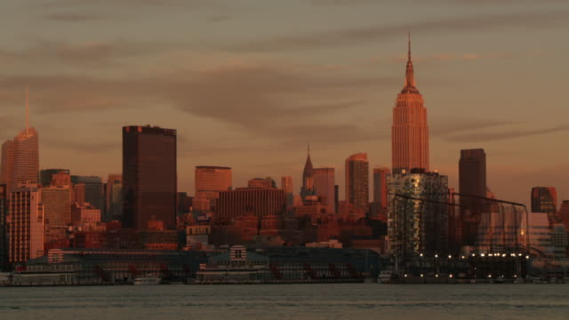 WS City painted with  golden sun reflection / New York City, New York, United States
