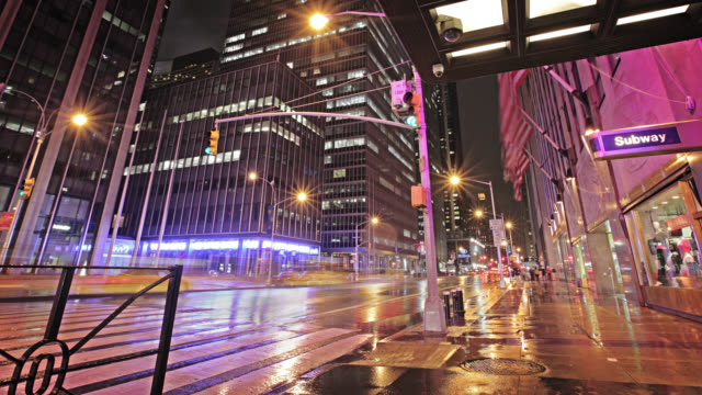 City, rain, traffic at night