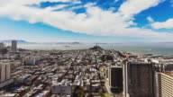 T/L city scape from high building overlooking San Francisco, Coit Tower and Alcatraz Island
