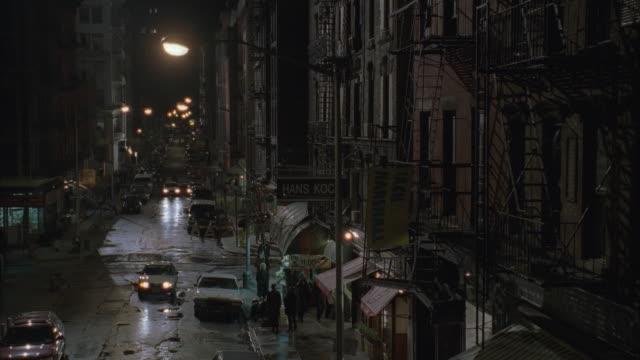 HA, PAN, MS, City street at night, New York City, New York, USA