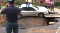 City Street Collapses Into Massive Sinkhole on August 02 2012 in Brooklyn New York