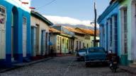 City street in Trinidad Cuba with vintage american car.
