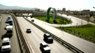 TL City traffic and road junction, the Olympic rings on the background / Russia, Sochi, Adler