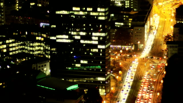 City traffic - busy intersection at night, downtown Frankfurt