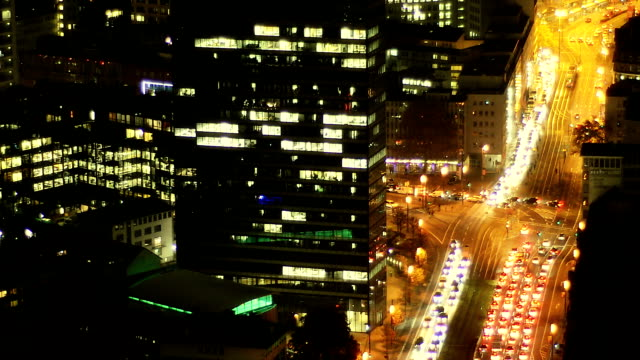 City traffic - busy intersection at night timelapse, downtown Frankfurt