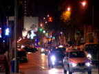 City traffic on Sunset Strip pan right to Whisky a Go Go club on corner