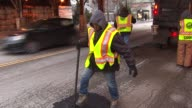 <<City workers filling potholes on Chicago streets>> on in Chicago Illinois