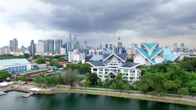 cityscape and skyline of kuala lumpur near water.