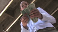 Cityscape in Downtown LAOne business woman counting cash
