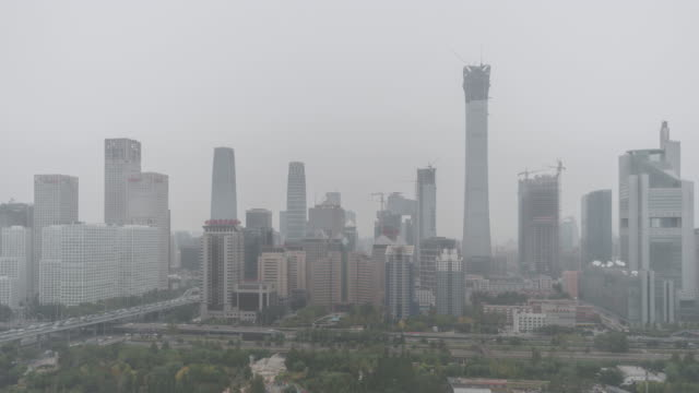 T/L HA ZI Cityscape of Beijing in air pollution / Beijing, China