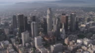 AERIAL Cityscape of downtown Los Angeles and numbered helipads / California, United States