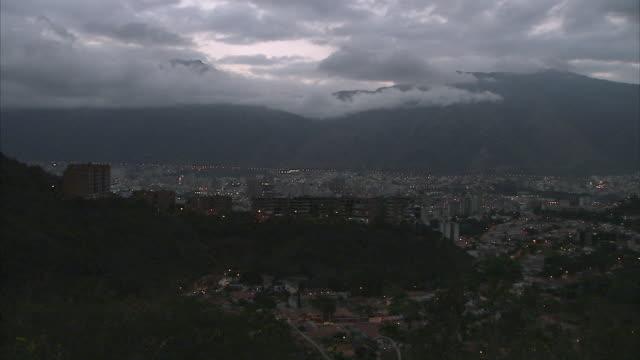 WS PAN Cityscape of Petare at dusk / Caracas, Miranda, Venezuela