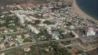 AERIAL WS Cityscape with luxury hotels and resorts / Praia da Luz, Faro, Portugal