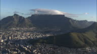AERIAL Cityscape with Table Mountain and Lion's Head, Cape Town, Western Cape, South Africa