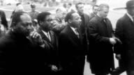 Civil Rights leader Martin Luther King leads peace march procession to the United Nations to urge UN pressure to force the US to stop bombing North...