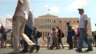 Civil servants and antiausterity protesters marched on parliament on Wednesday after going on strike ahead of a parliamentary vote on draconian...