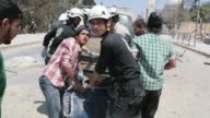 Civilians and members of the Hanano Civil Defense team a group of volunteer first responders carry bodies away from a bombing site in Aleppo Syria on...