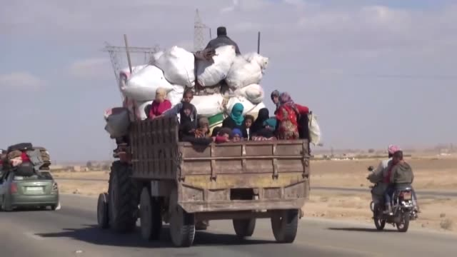 Civilians flee Syria's Deir ezZour city as Syrian regime forces and their allied militias carry out an offensive to retake the city from Daesh on...