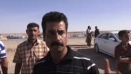 Civilians who have fled take shelter at tent camp in AtTartar region of northern Anbar Iraq on May 29 2016 Civilians said they were exposed to random...