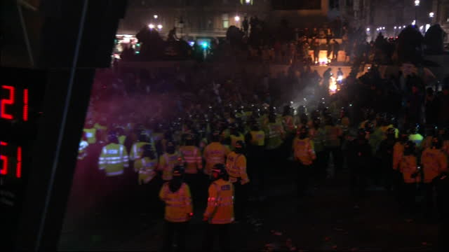 Clashes between police protestors have continued tonight in Trafalgar Square after the biggest march for 8 years was again hijacked by anarchists...