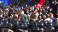 Clashes broke out between police and right wing protesters outside outside the Ukrainian parliament in Kiev Tuesday as hundreds took to the streets...