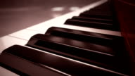 Classic piano keyboard close-up. Loopable CG.