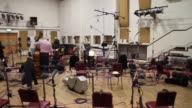 Classical musicians assembling in the famous Abbey Road Studios in London made famous by The Beatles