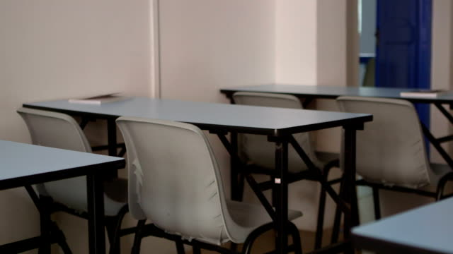 Classroom desk and chairs dolly shot