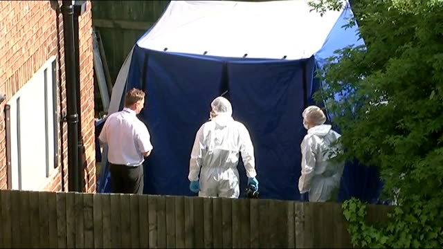 man arrested and released on bail ENGLAND York Police and forensic officers beside incident tent in garden of Michael Snelling
